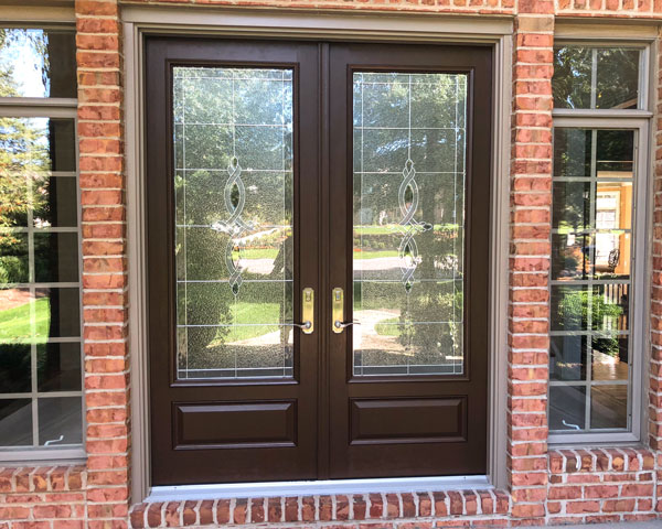 black french doors on brick house