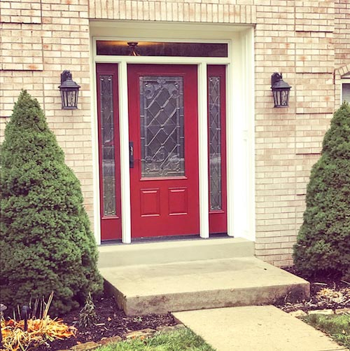 red front door with window and white frame