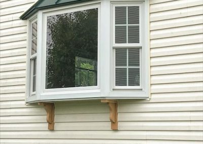 White Bay Window With Green Overhang