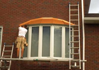 Bay Window With Copper Overhang