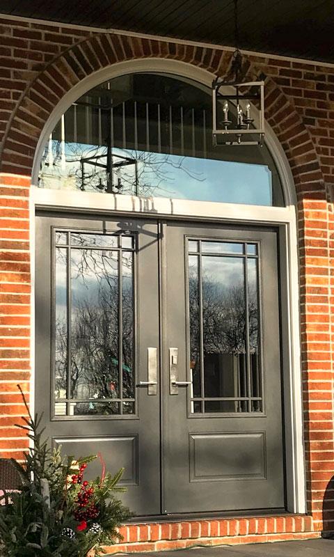Black front door on brick house